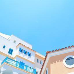 FreeToEdit blue sky background building multicolor architecture